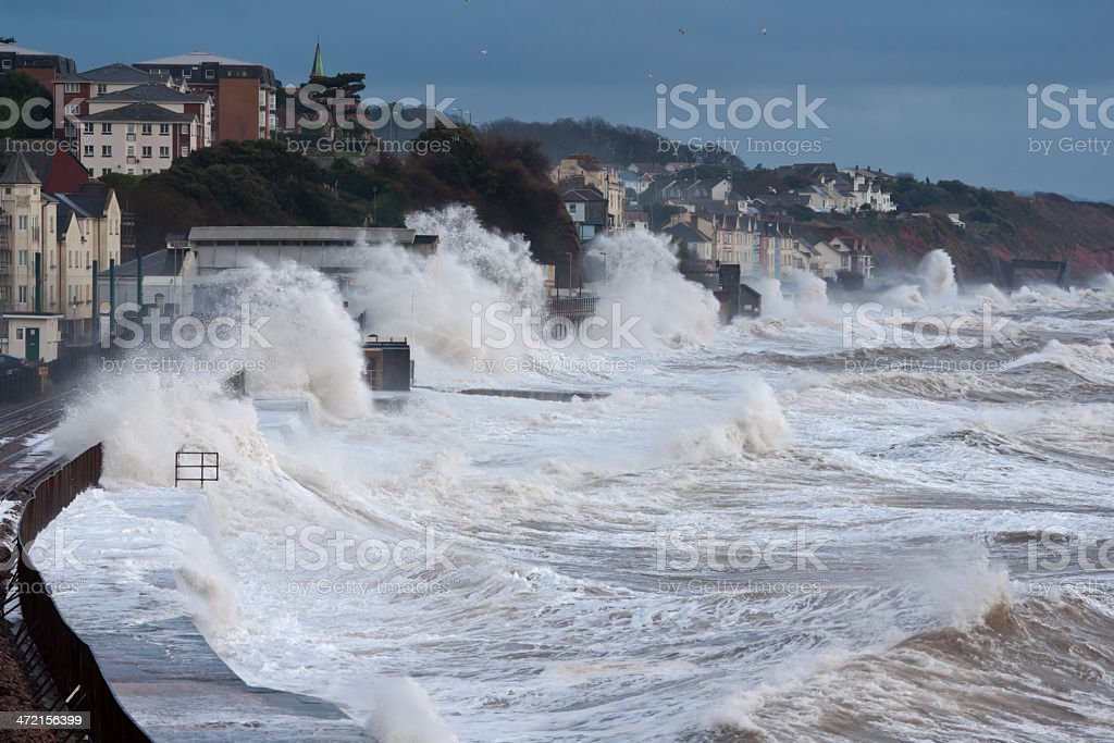 Severe storm at Dawlish with large waves over railway stock photo