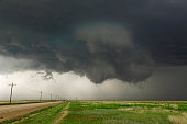 Severe thunderstorm lowering cloud threatens tornado