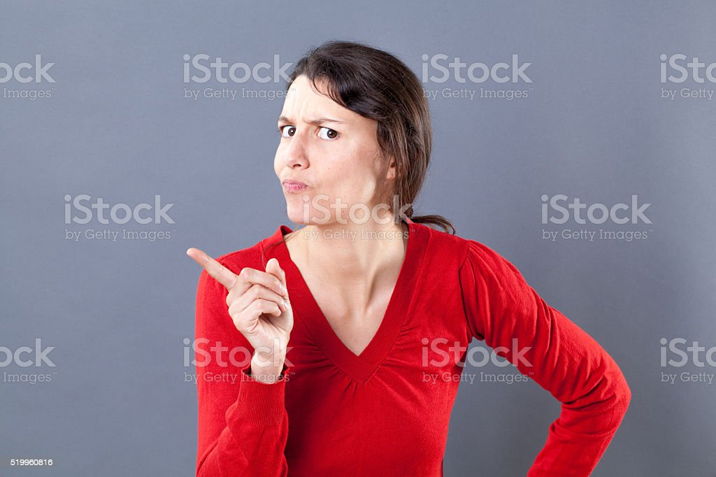 severe young woman grumbling, acting like a judge mental stock photo
