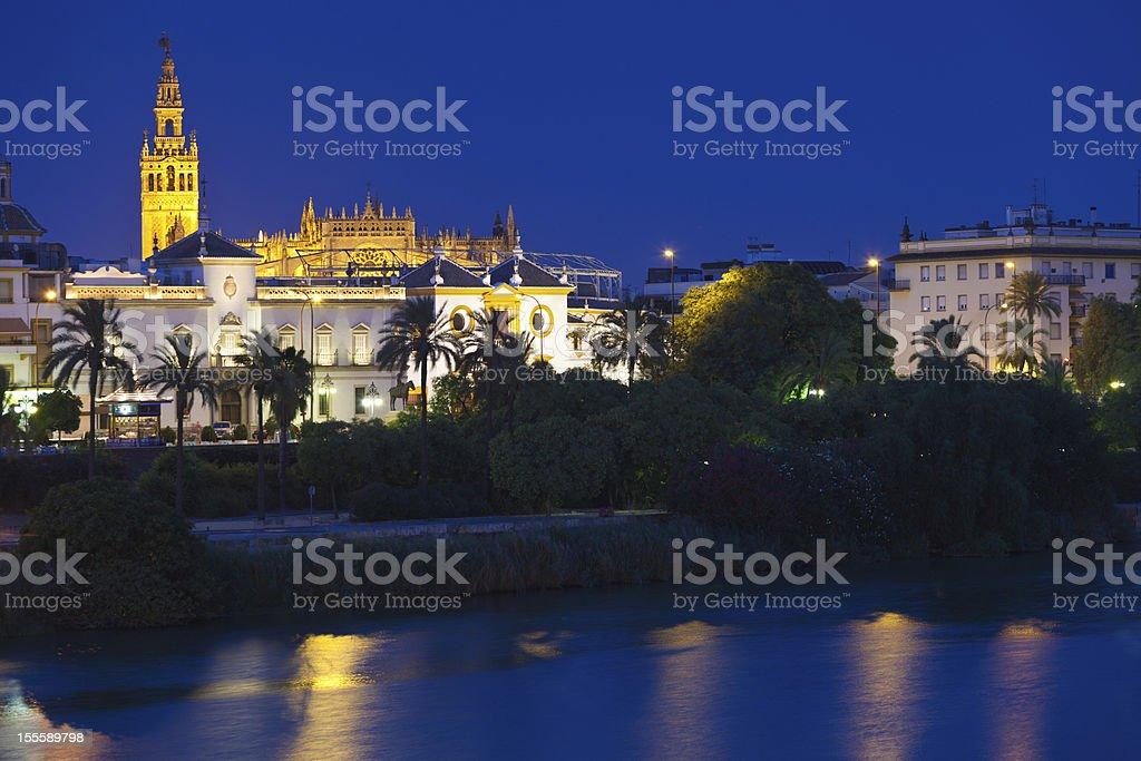 Sevilla Cathedral over Maestranza bullring at night, Spain royalty-free stock photo