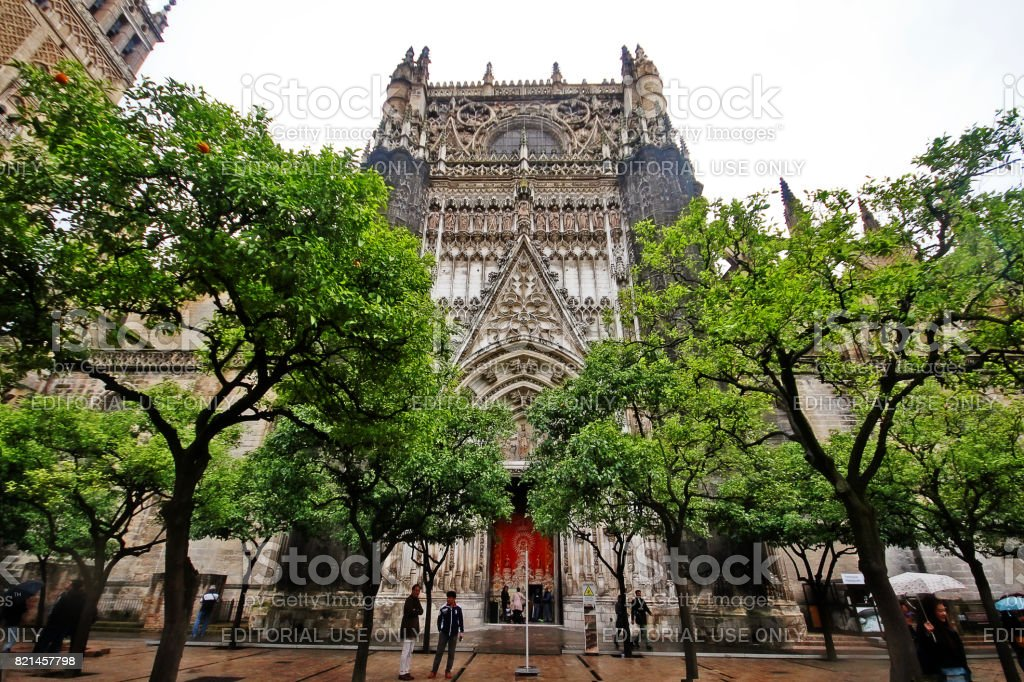 Seville, Andalusia, Southern Spain - March 14, 2017 - Door of the Conception, in the North facade at Patio de los Naranjos of Cathedral of Saint Mary of the See (Catedral de Santa Maria de la Sede), or Seville Cathedral stock photo