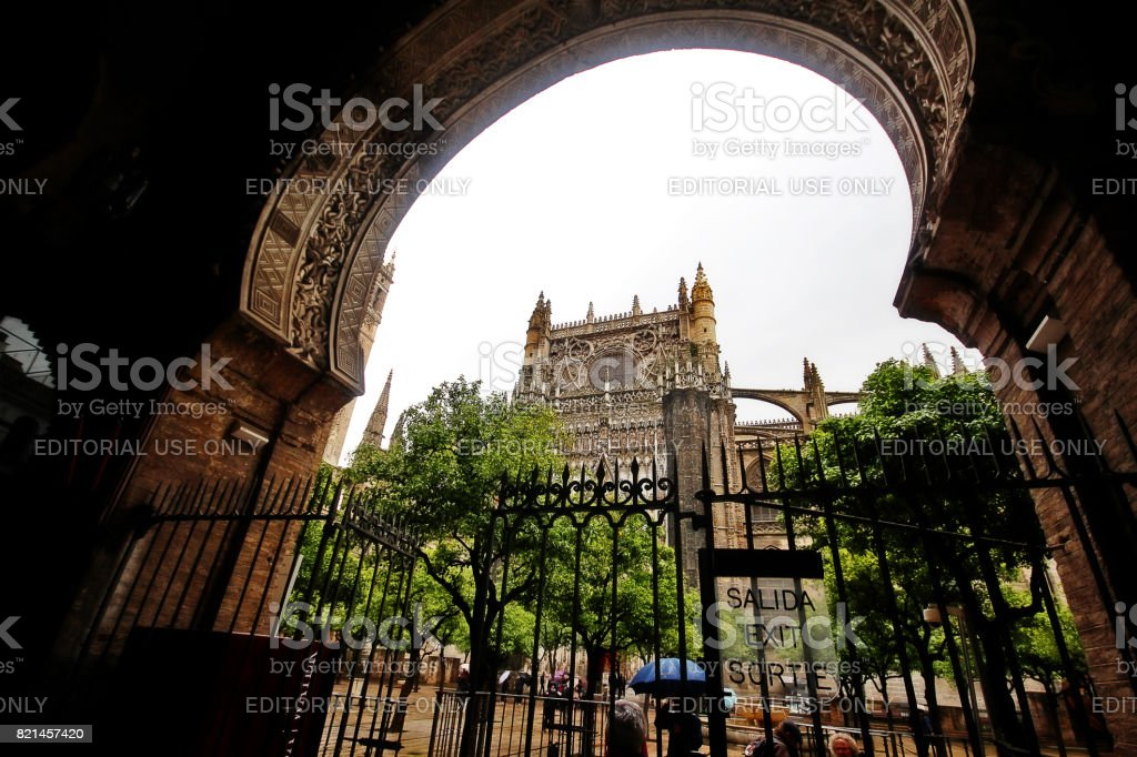 Seville, Andalusia, Southern Spain - March 14, 2017 - Patio of the Oranges Gate, Gate to the Patio de los Naranjos, part of the old Almohad mosque, now annexed to the Seville Cathedral stock photo