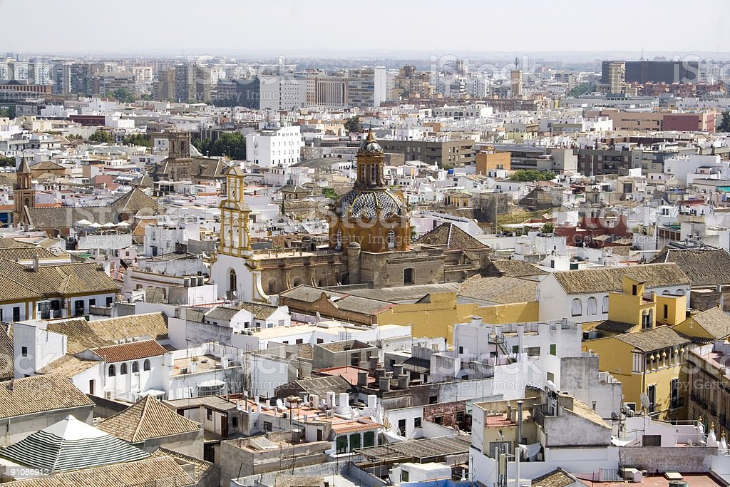 Seville cityscape with Santa Cruz church royalty-free stock photo