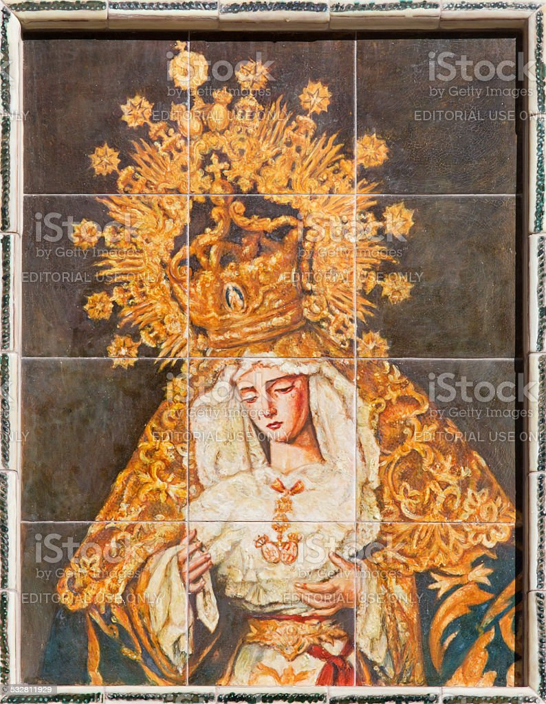 Seville - The ceramic tiled cried Madonna stock photo