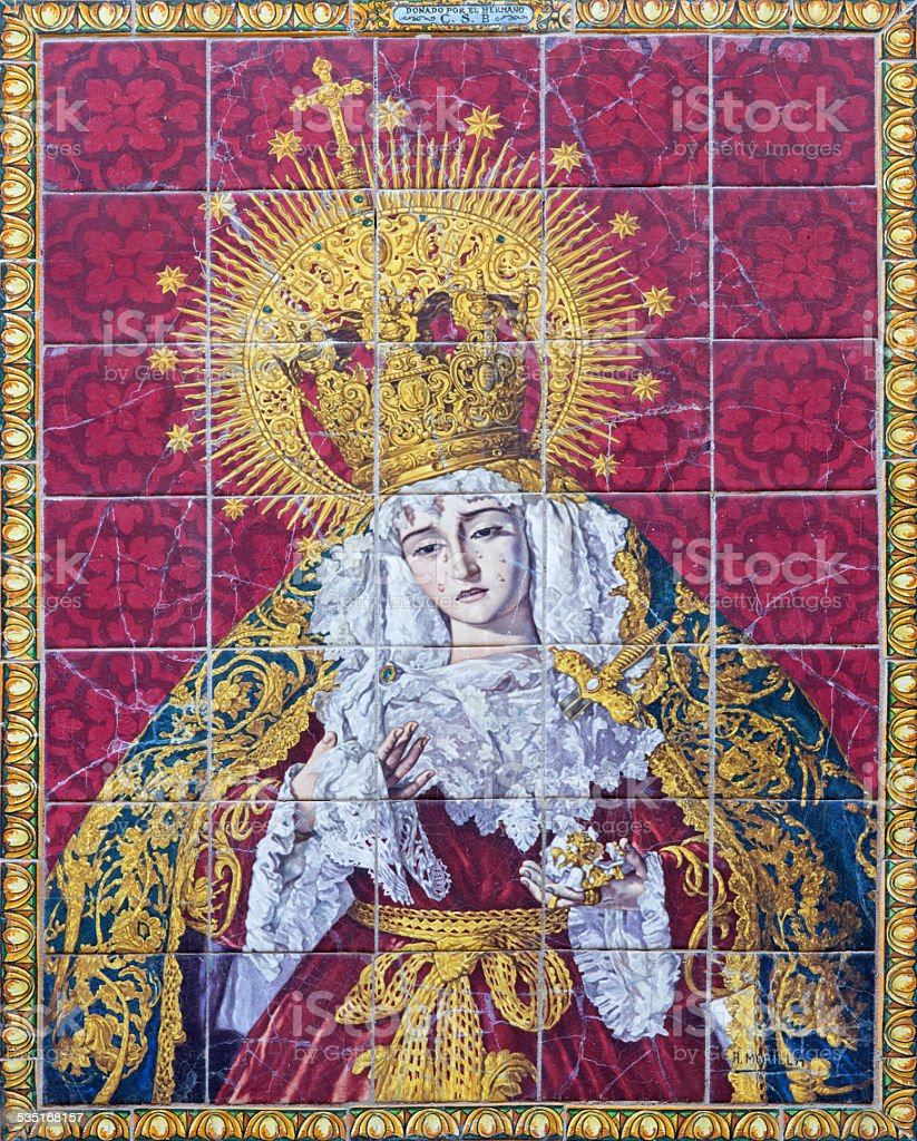 Seville - The ceramic tiled Lady of Sorrow stock photo