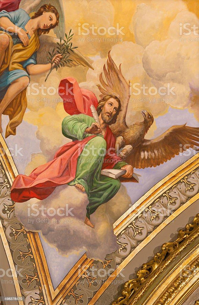 Seville - The fresco of st. John the Evangelist stock photo