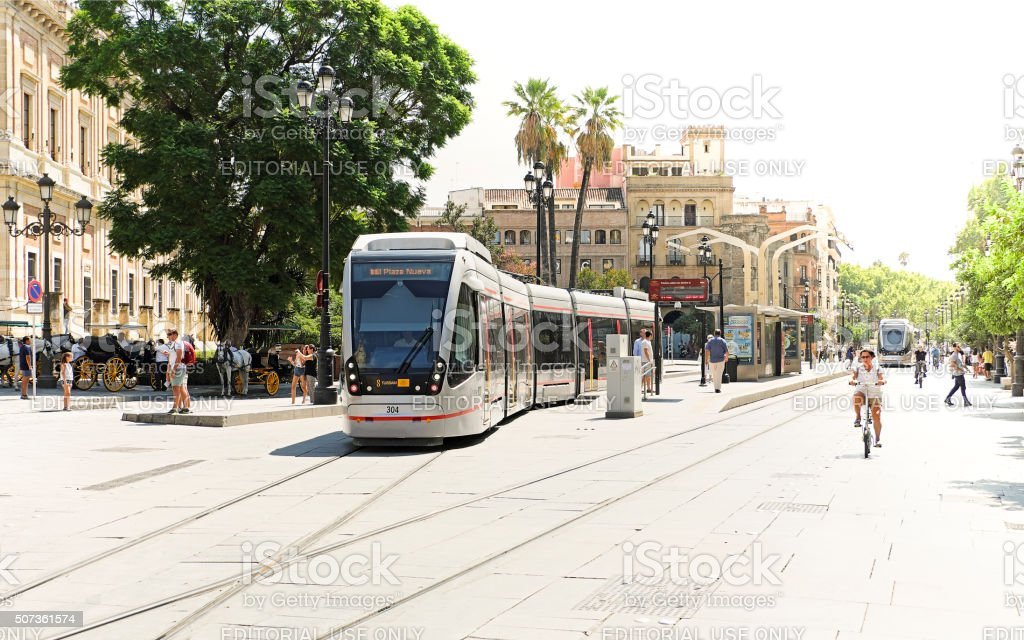 Seville trams (light rail) blend with historic city centre stock photo