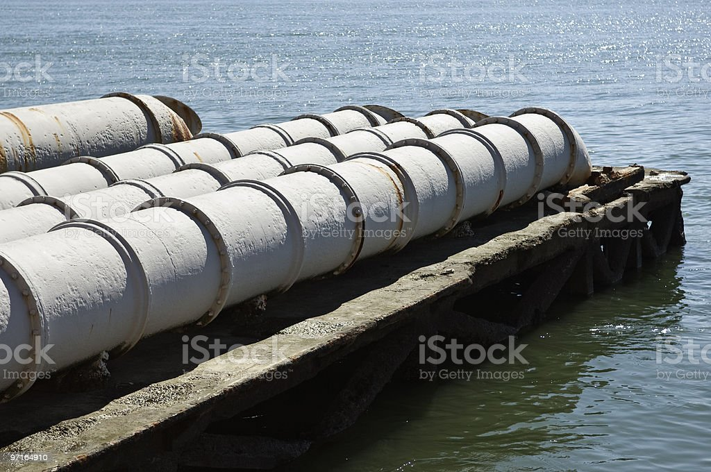 Sewage into the river stock photo