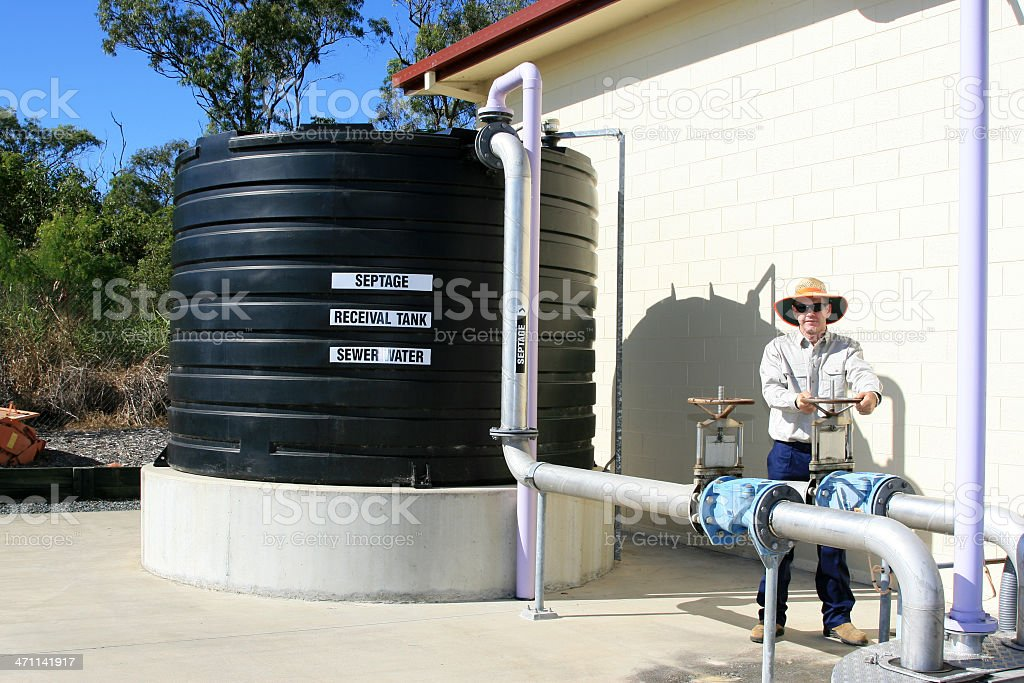 Sewage Tank & Plant Worker at water treatment plant stock photo