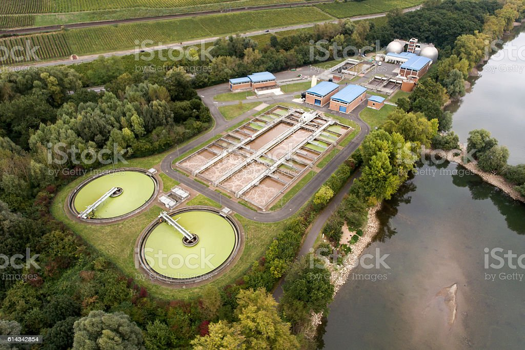 Sewage treatment plant water river - aerial view stock photo