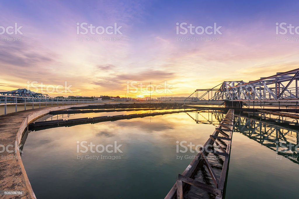 sewage treatment plant with sunrise stock photo