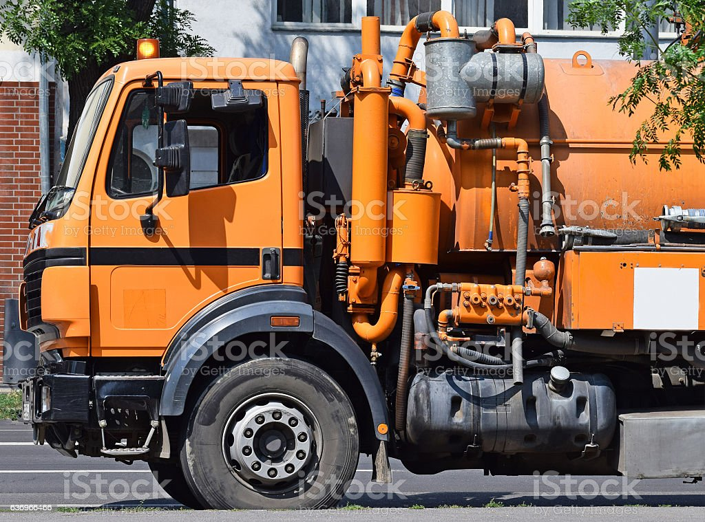 Sewage truck on the street stock photo