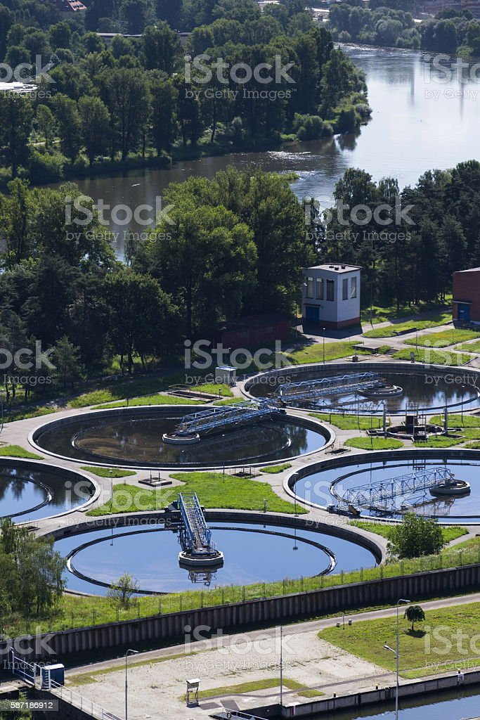 Sewage water treatment plant with river in background aerial view stock photo