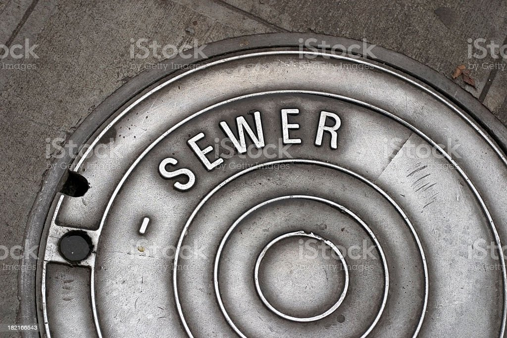 Sewer Manhole Cover stock photo