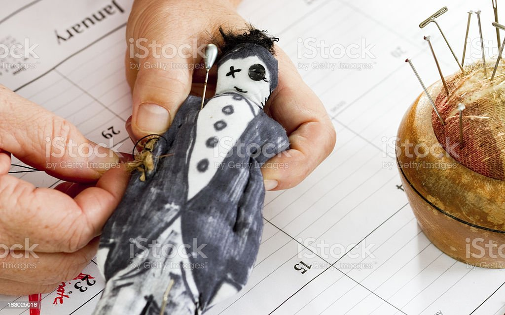 Sewing a Boss Voodoo Doll. Employment issues stock photo