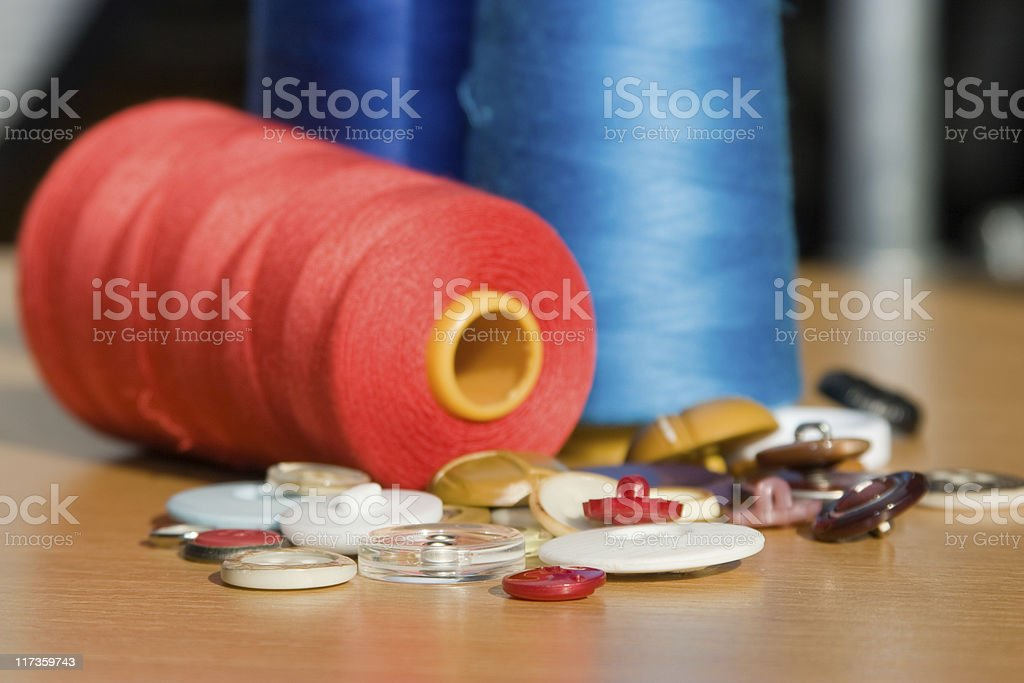 Sewing accessories: Buttons and thread royalty-free stock photo