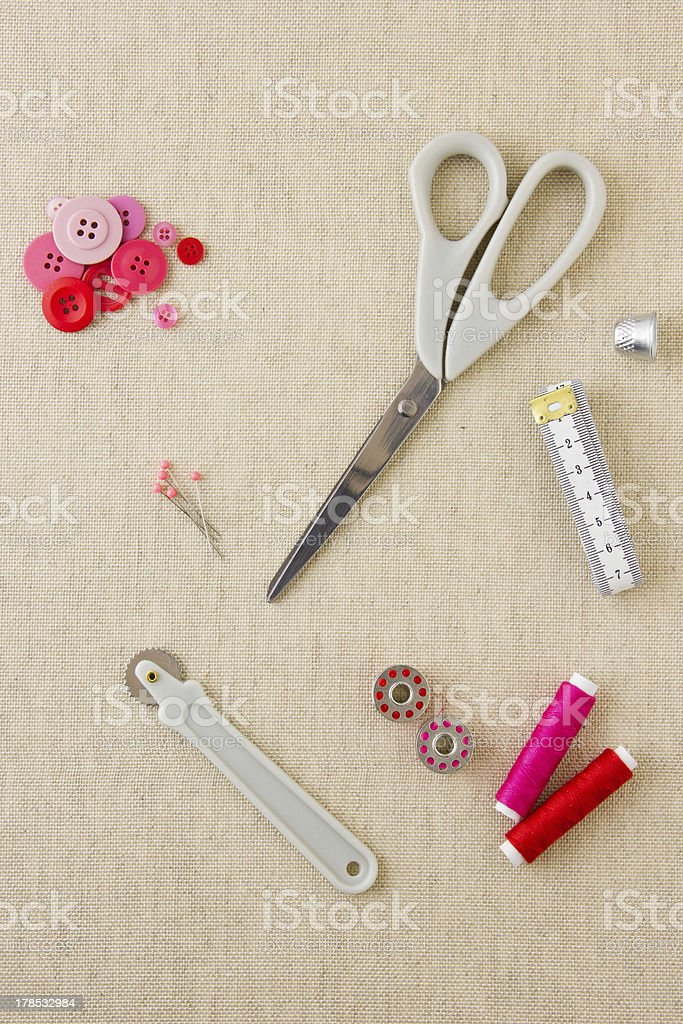 Sewing accessories in red and pink tones royalty-free stock photo
