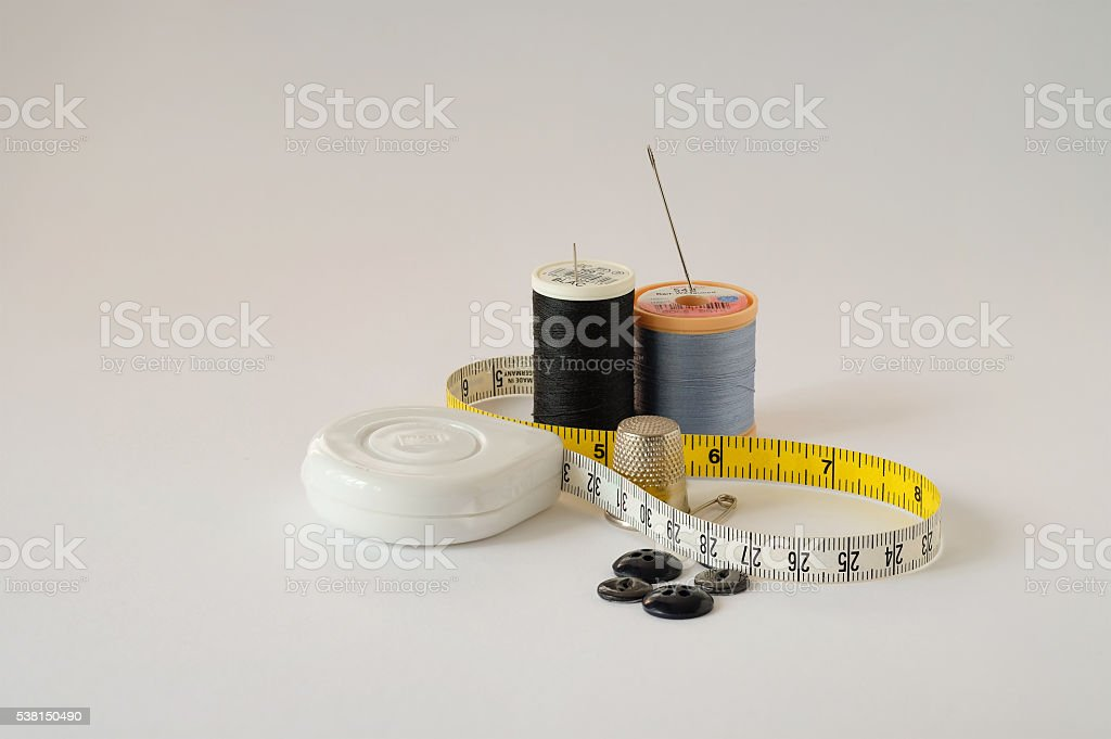 Sewing accessories on white background stock photo