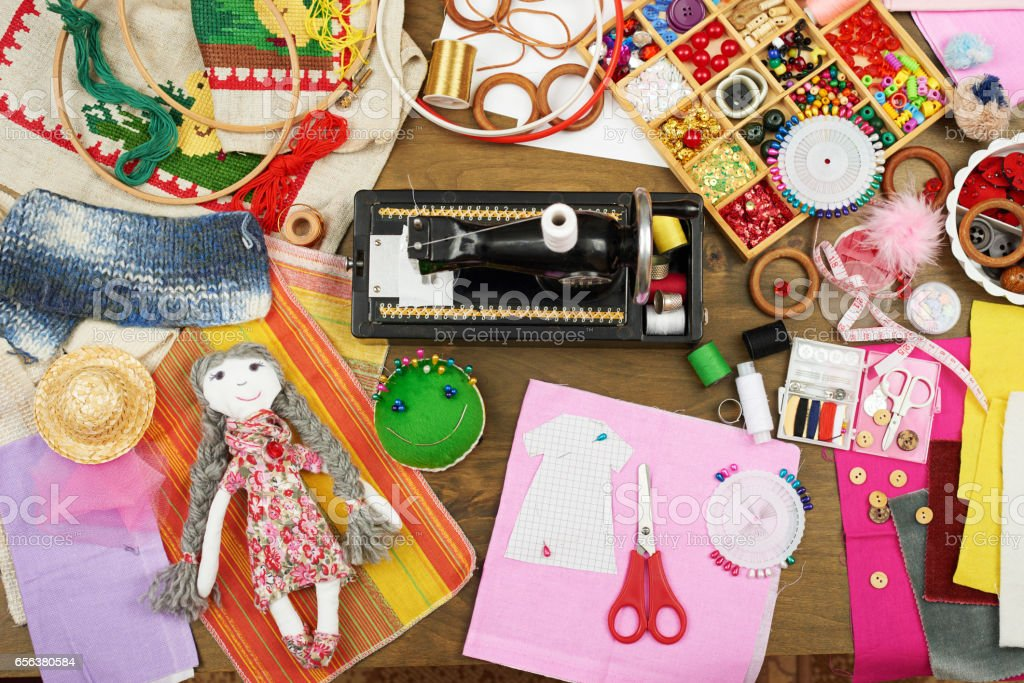 sewing accessories top view, seamstress workplace, many object for needlework, embroidery and handicraft stock photo