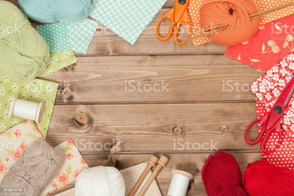 Sewing And Knitting Accessories. Fabric, Yarn Balls. Wooden Tabl stock photo
