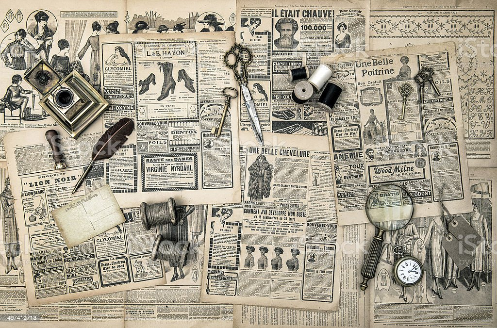 sewing and writing tools, vintage fashion magazine stock photo
