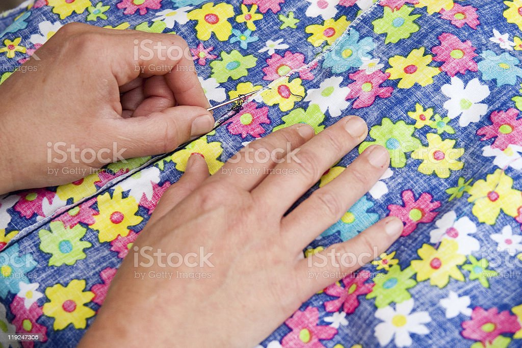 Sewing Brightly Coloured Floral Dress royalty-free stock photo