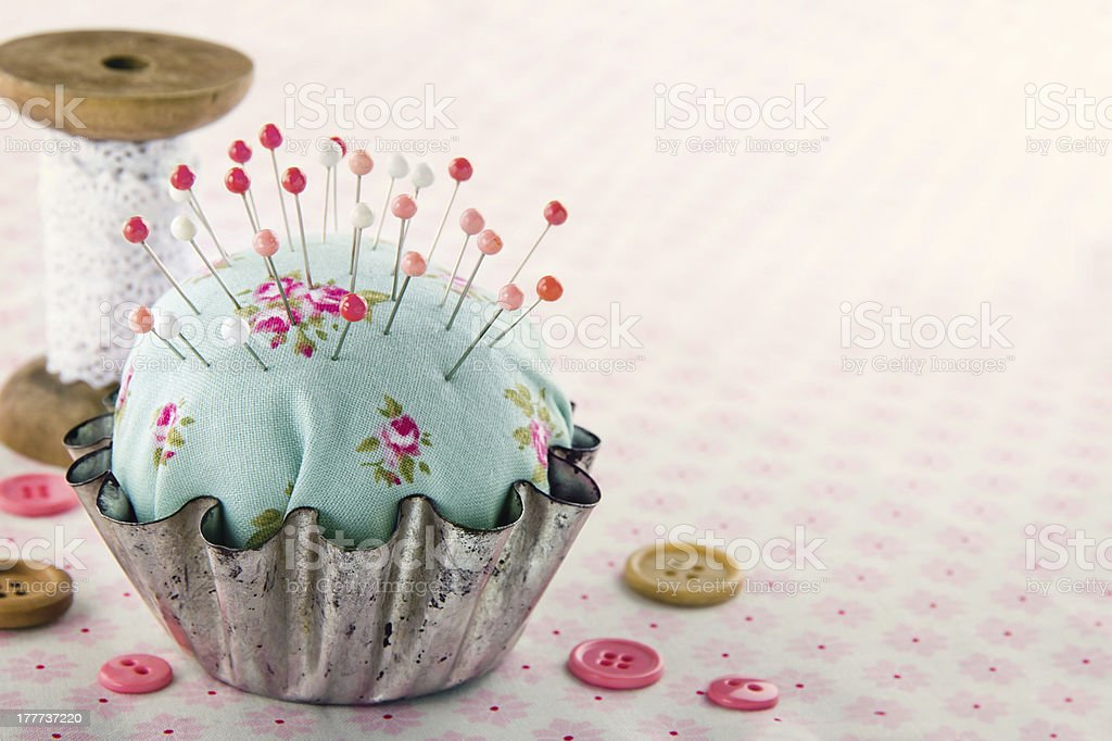 Sewing concept background with floral pincushion royalty-free stock photo