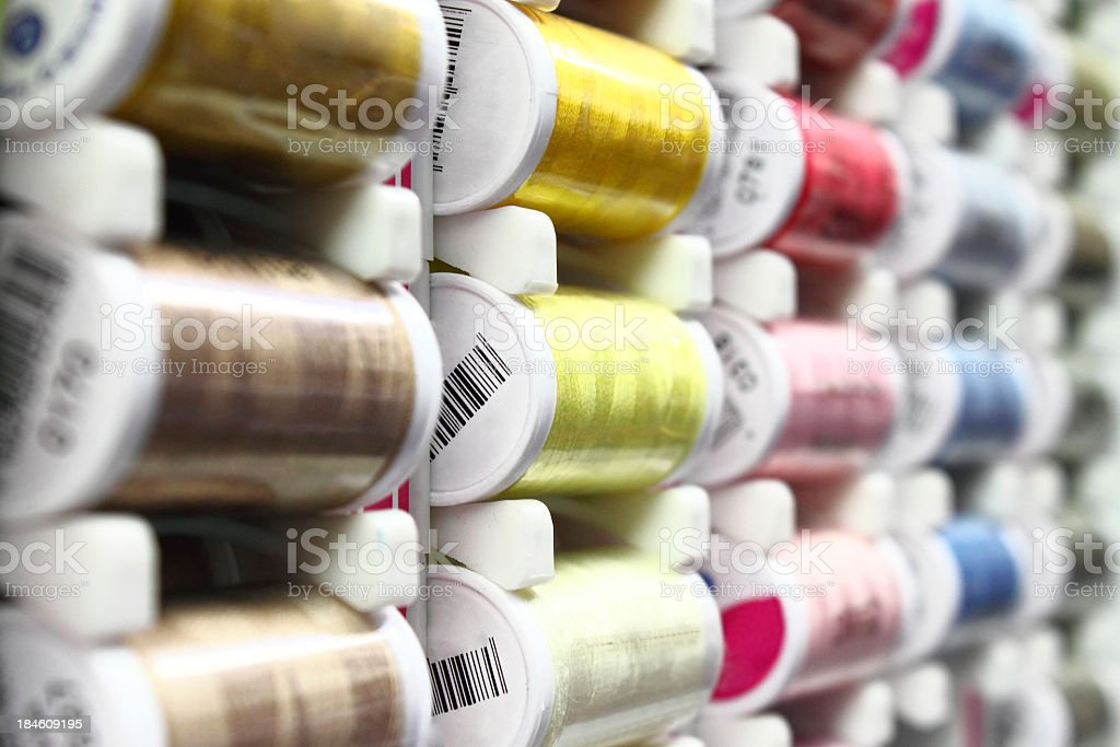 Sewing cotton bobbins stock photo