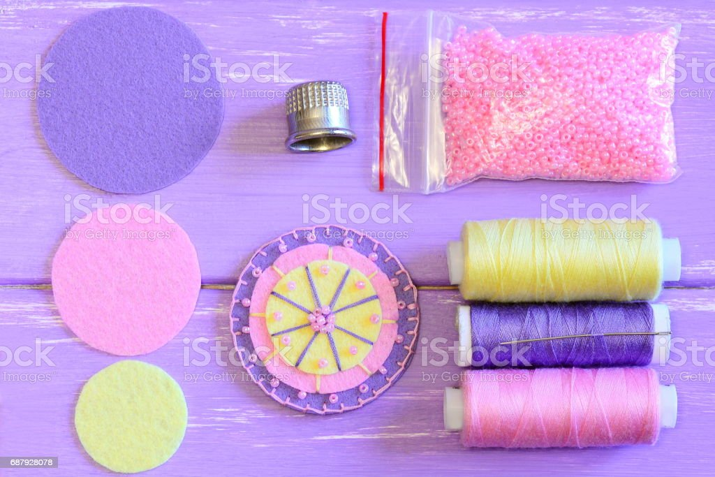 Sewing felt flower tutorial. Simple round felt flower crafts for kids. Top view stock photo