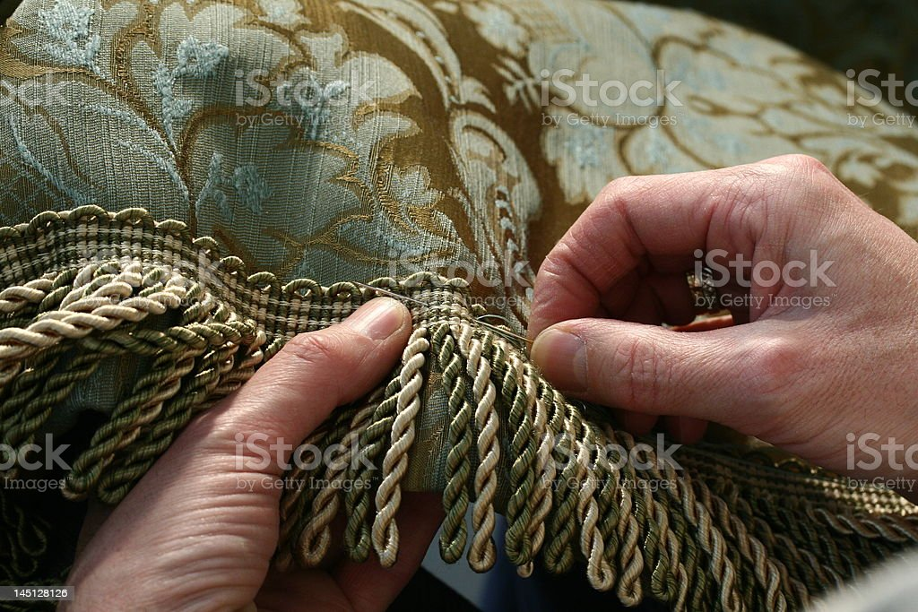 Sewing fringe to a drape royalty-free stock photo