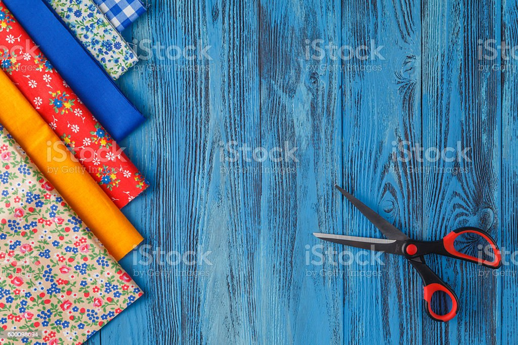 Sewing items on blue table stock photo