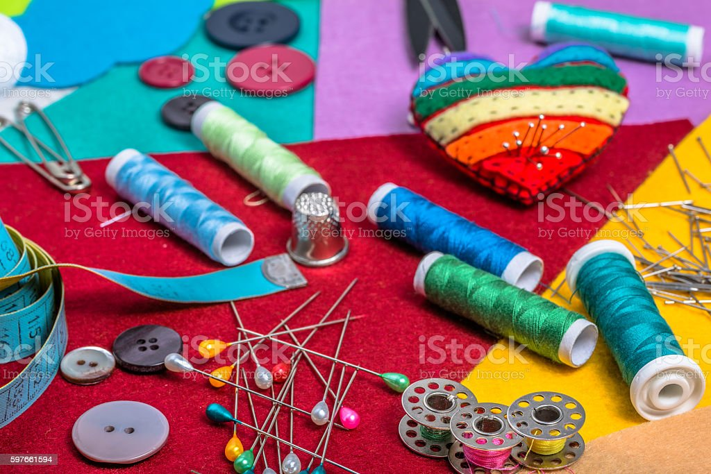 Sewing kit on a colored felt. stock photo