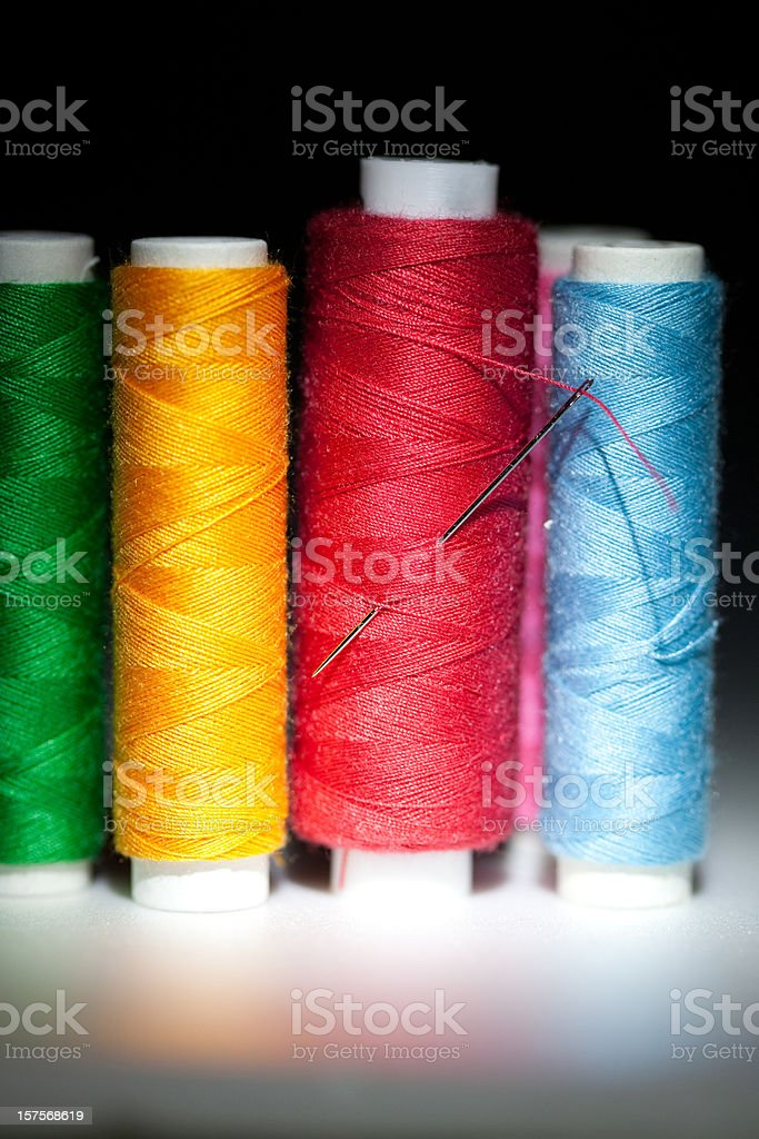 Sewing kit with colorful threads stock photo