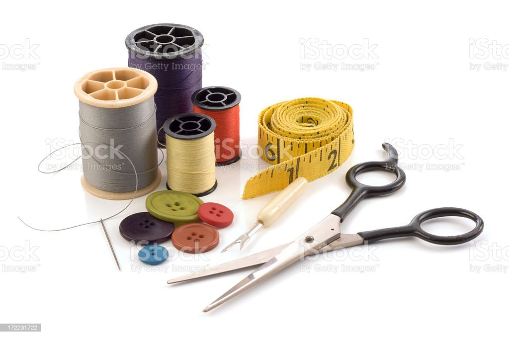 Sewing Kit with Needle, Thread, Button, Scissors, and Tape Measure stock photo