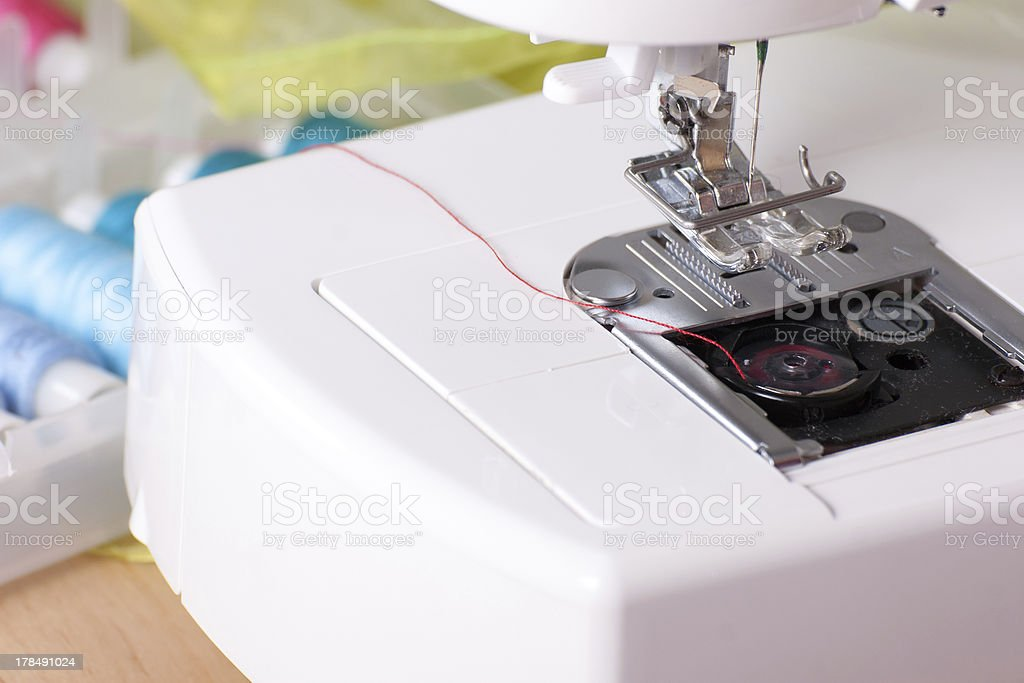 Sewing Machine and Spools of Thread stock photo