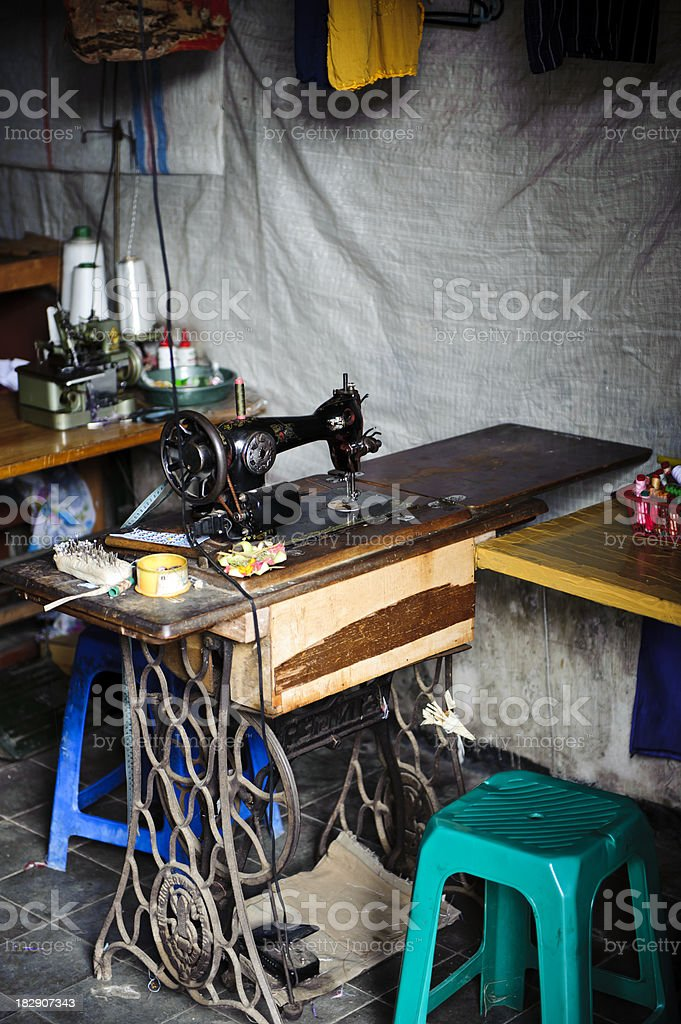 Sewing machine in third world country stock photo