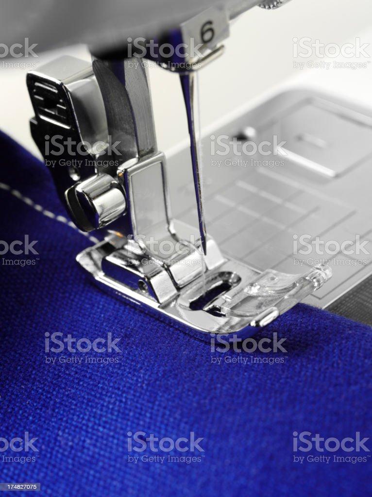 Sewing Machine Needle on Blue Fabric royalty-free stock photo