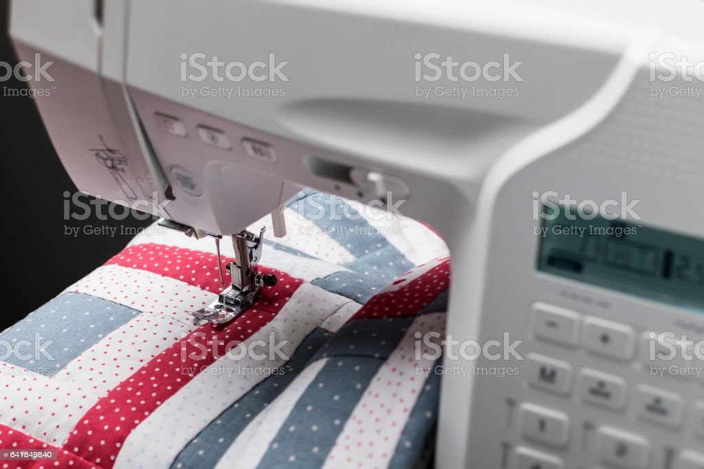 Sewing machine with quilt stock photo