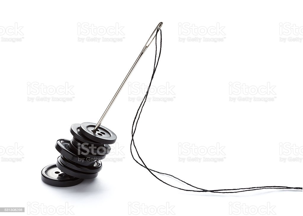 sewing needle and string tailor craft stock photo