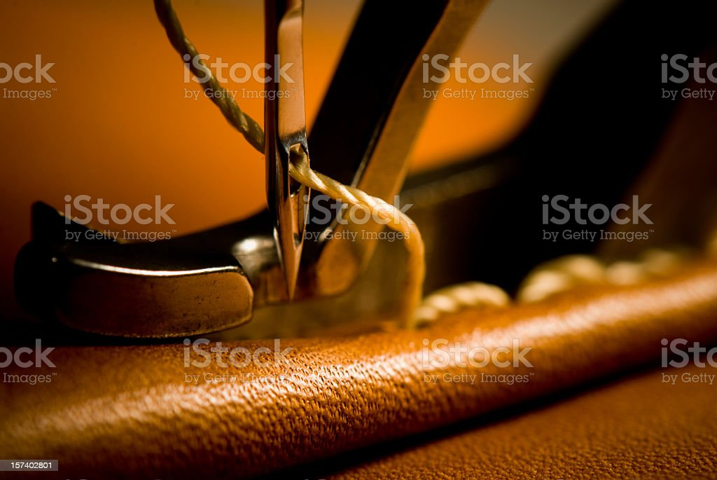 Sewing needle of sewing machine making stitches stock photo