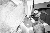 Sewing. Old woman sewing weeding dress