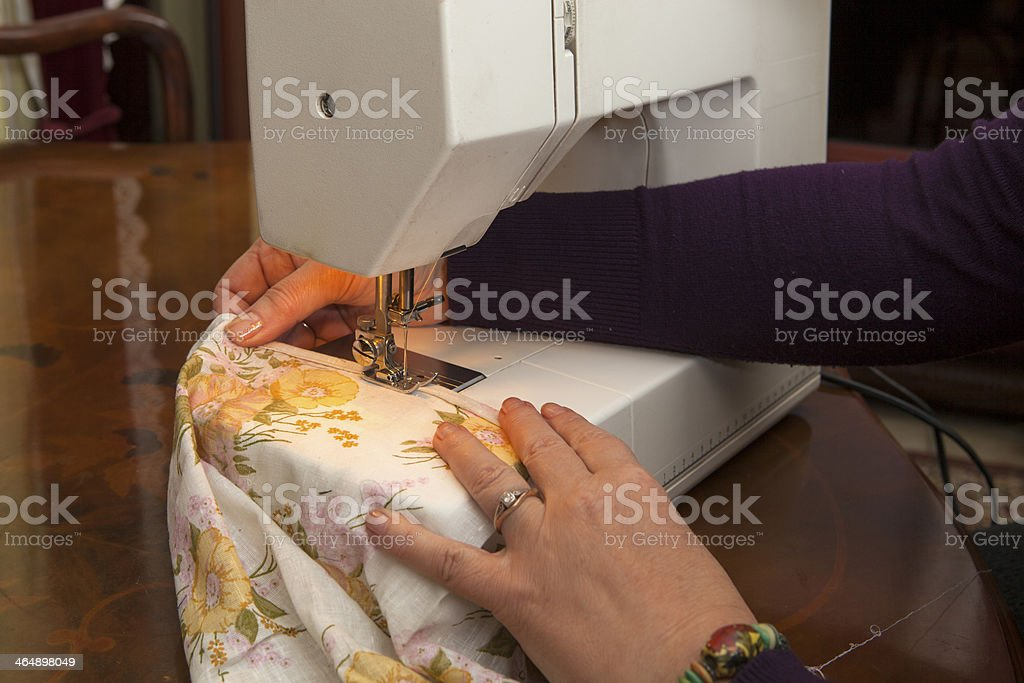 Sewing on a sewing-machine royalty-free stock photo