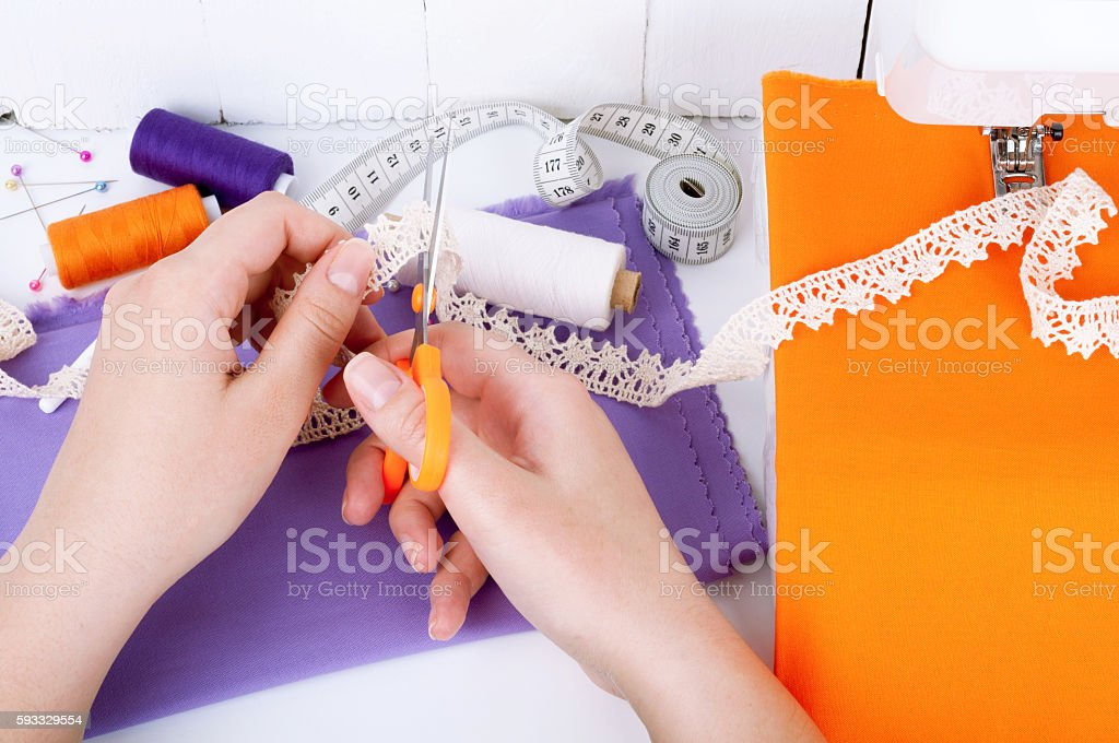 Sewing on the sewing machine. Set of needlework stock photo