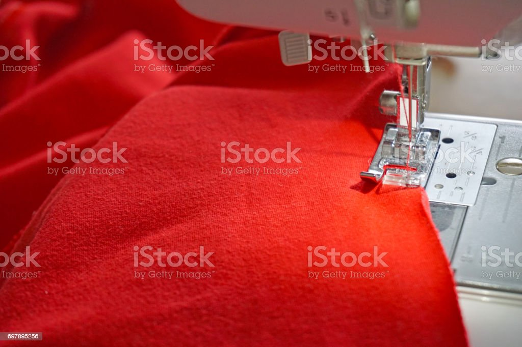 Sewing process trousers on a sewing machine background stock photo