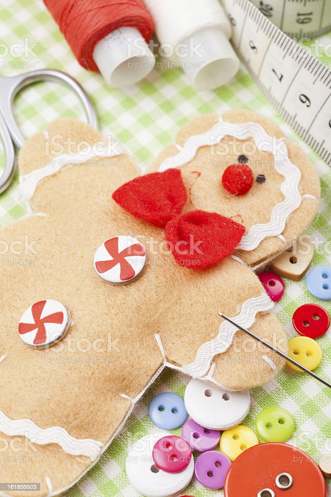 Sewing set and handmade gingerbread man from textile royalty-free stock photo