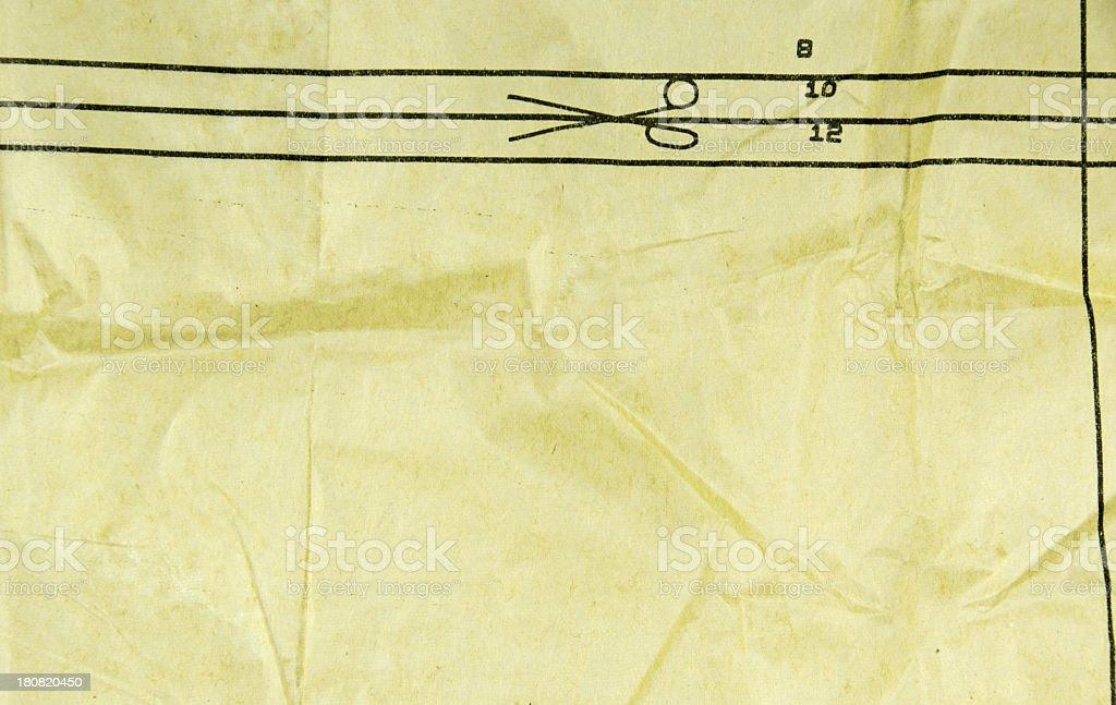 Sewing thin paper pattern cutouts stock photo