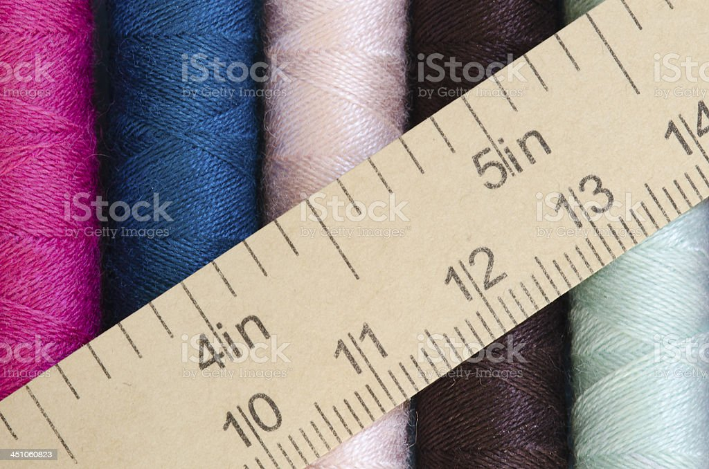 sewing thread and measuring tape background stock photo