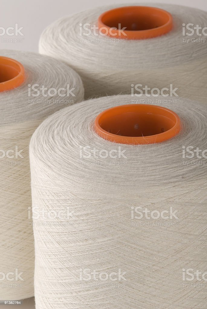 Sewing thread spools, natural fiber, close up, elevated view royalty-free stock photo