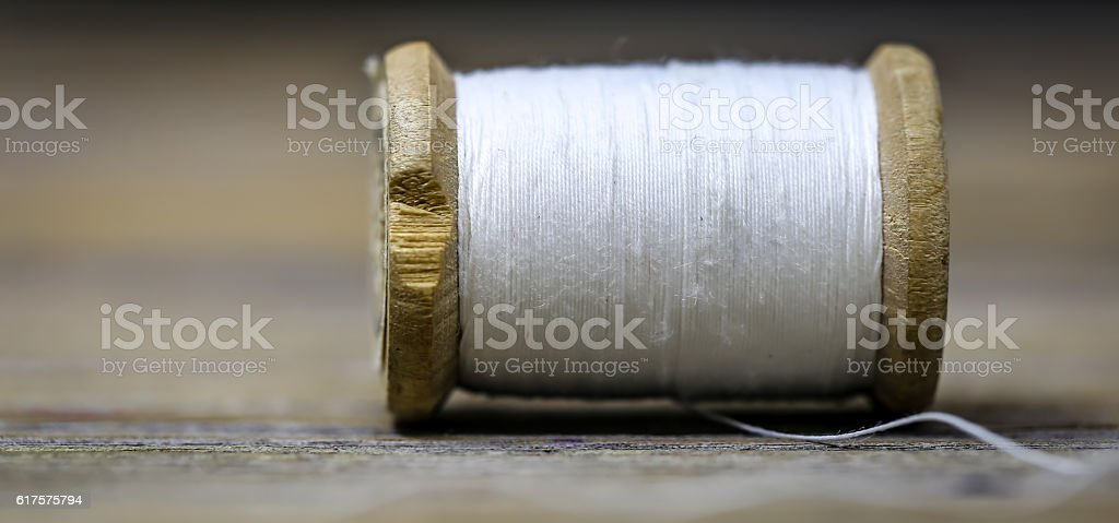 Sewing thread white color with a needle stock photo