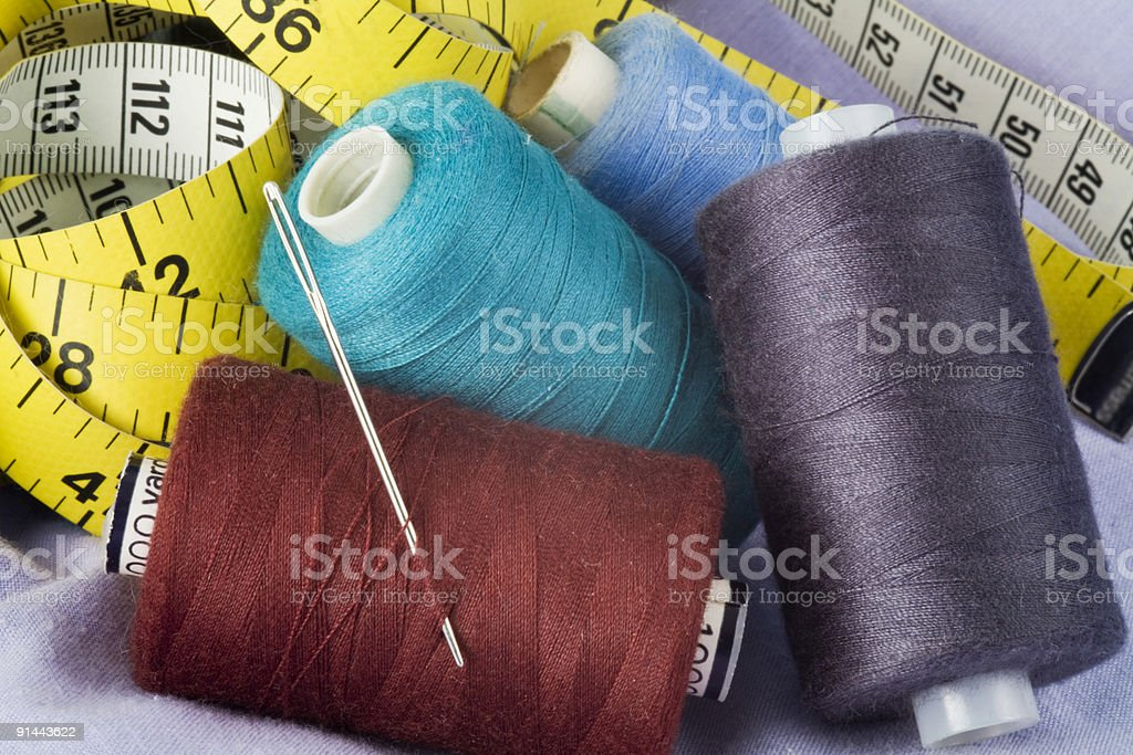 Sewing threads and needle royalty-free stock photo